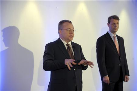 Nokia's CEO Elop gestures as Chairman Siilasmaa looks on, at a news conference prior to the Annual General Meeting of Nokia Corporation in Helsinki