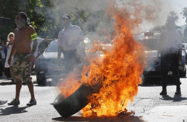 Taxi drivers on strike burn tyres during a national protest against car-sharing service Uber in Marseille