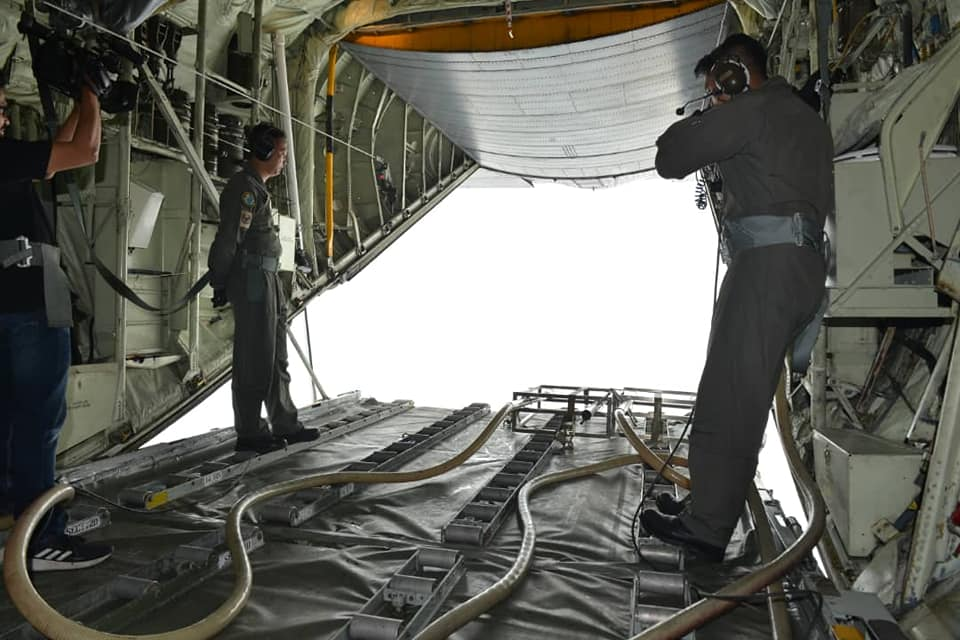 View from the RMAF's C-130 during the cloud seeding operation.