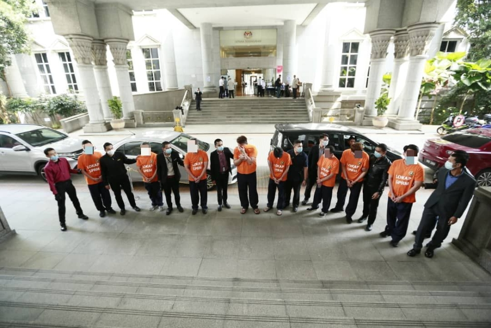 telco staff arrest