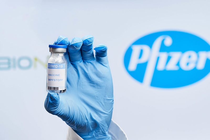 Doctor holding BioNTech and Pfizer Covid-19 vaccine